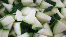 Closeup of chopped zucchini with selective focus Footage
