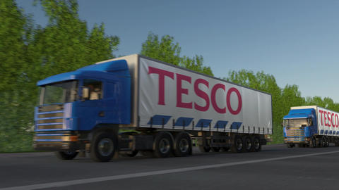 Freight semi trucks with Tesco logo driving along forest road, seamless loop Footage