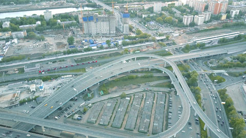City road interchange and moving commuter train Footage