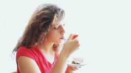 Young woman trying, tasting and eating portion piece of tiramisu cake at kitchen Footage