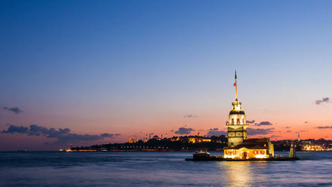 Pan shot timelapse of Maiden Tower or Kiz Kulesi with floating tourist boats on Footage
