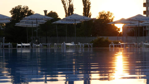 Sunset reflections in the water of a swimming pool ภาพวิดีโอ