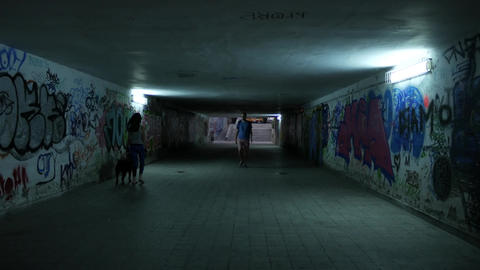 Underground subway underpass with graffiti art on the walls ภาพวิดีโอ