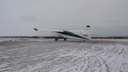 Plane Preparing To Take Off On Snowy Runway stock footage