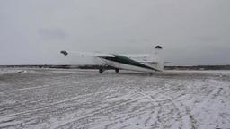 Plane preparing to take off on snowy runway Footage