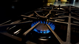 4K UHD Video Of Kitchen Gas Stove Top Burner Flame Turned Up stock footage