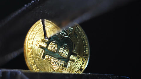 Closeup Golden Bitcoin Model Cut with Sharp Knife Live Action