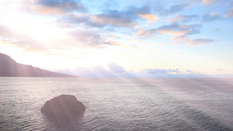 Seascape at sunrise with rays of the sun through the clouds Footage