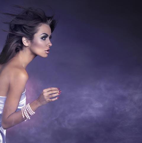 Smart, sensual lady wearing white, shiny dress フォト