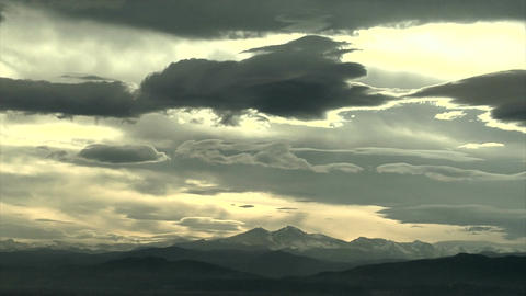 Awesome cloud timelapse over mountain range Footage