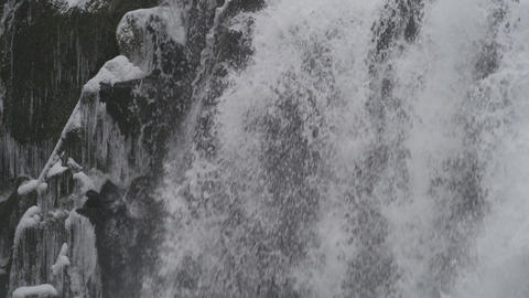 Close up on rushing waterfall in winter landscape Footage