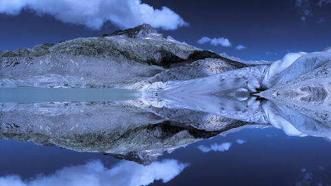Epic mountain landscape scenery reflecting in lake water Live Action