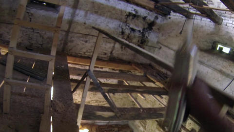 Worker climb the wooden stairs of an old stone tower in ascent to the upper Footage