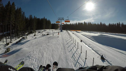 Driving the chairlift from the view of the skier Footage
