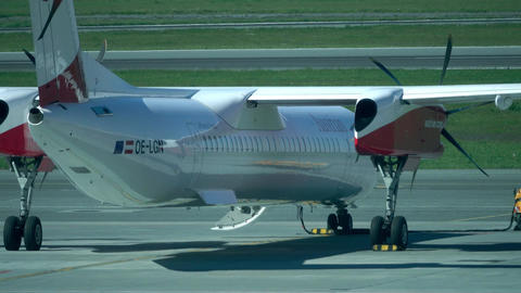 WARSAW, POLAND - MAY, 18, 2017. Parked Austrian Airlines Bombardier propeller Footage
