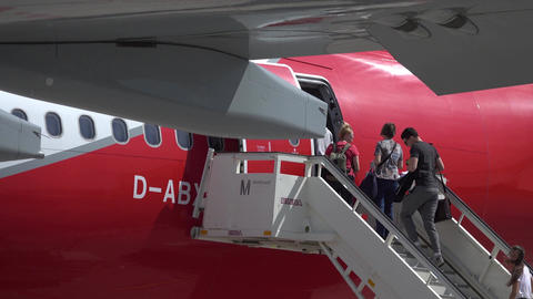 BERLIN, GERMANY - MAY, 18, 2017. Passengers boarding Air Berlin airliner at the Footage