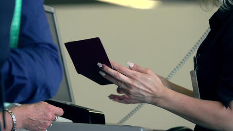 Flight attendant checking passports and boarding cards at airport terminal gate Footage