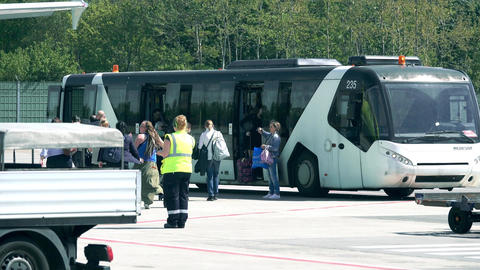 BERLIN, GERMANY - MAY, 18, 2017. Passengers boarding Neoplan airfield bus at the Footage