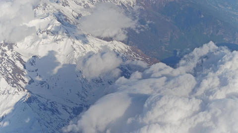 The Alps snowy mountain peaks and white clouds Footage