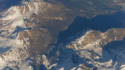 Flying above the Alps mountains and alpine towns in a valley Footage
