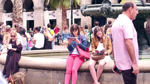 BARCELONA, SPAIN - APRIL, 16, 2017. Two young women examining city tourist guide Footage