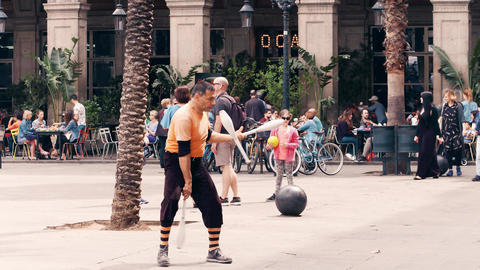 BARCELONA, SPAIN - APRIL, 16, 2017. Mature juggler performing in the street. 4K Footage