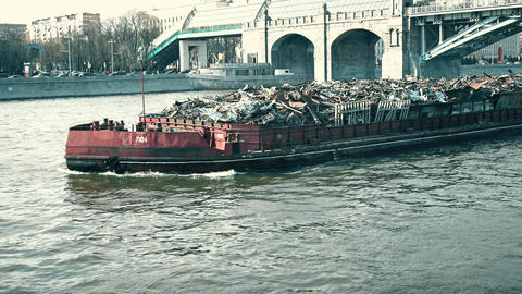 MOSCOW, RUSSIA - APRIL, 29, 2017. Pushed barge full of industrial trash being Footage