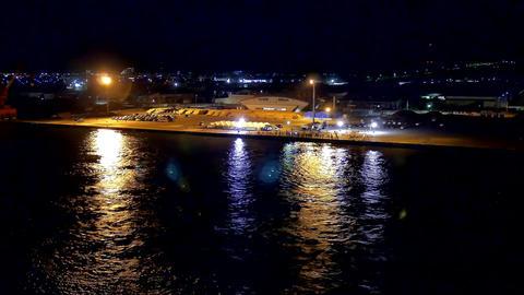 night shot of cruise ship leaving showa south wharf of sakaiminato Footage