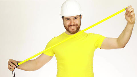 Happy construction engineer or architect using measure tape Footage
