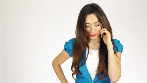 Young brunette woman talking on her mobile phone Footage