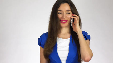 Beautiful young brunette woman talking on her cellphone Footage