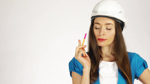 Portrait of pensive female construction engineer or architect in hard hat Footage