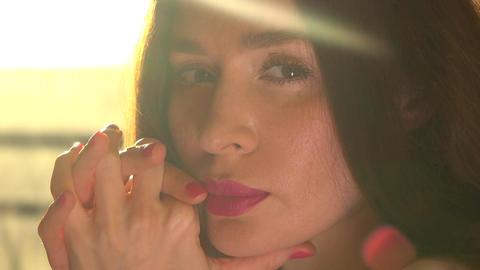 Portrait of pensive beautiful brunette woman in sunny room Footage