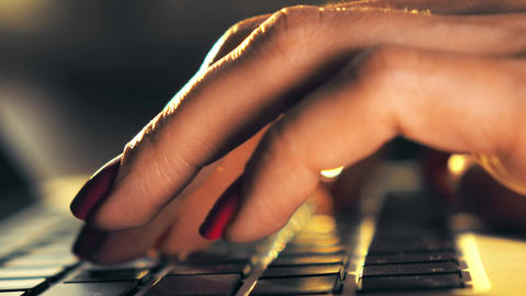 Beautiful female hands typing on laptop keyboard ビデオ