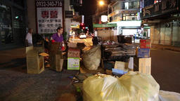 Taiwanese workers collecting and sorting recyclable garbage at night Taipei city Footage