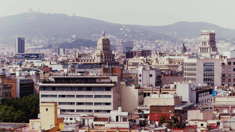 BARCELONA, SPAIN - APRIL, 15, 2017. Long pan shot of cityscape and rooftops. 4K Footage