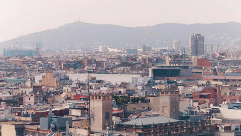 Barcelona rooftops and distant mountains Spain Footage