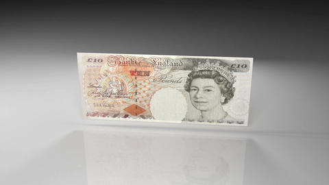 Close up of British pound banknote in rotation view on a glossy surface Animation