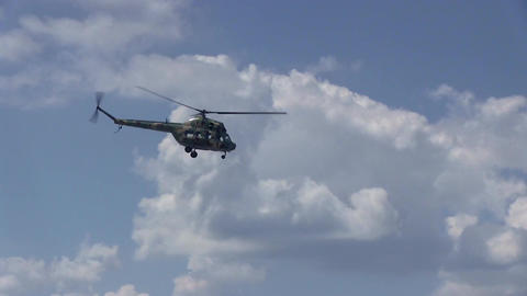 Military Helicopter Flies On The Blue Sky Footage