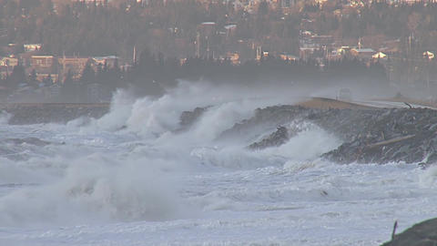 Waves crashing into homer spit road during storm in alaska Live Action
