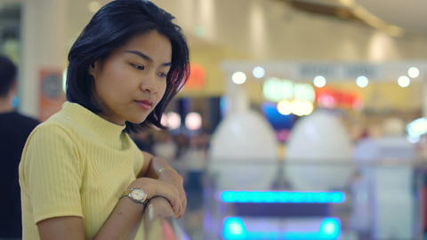 Portrait of Asian Woman near handrail in shopping mall Footage