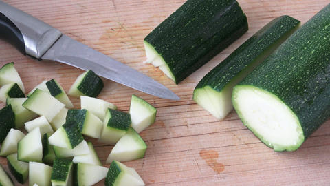 Cut zucchini on chopping board for cooking Footage
