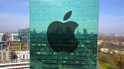 Aerial shot of office skyscraper with Apple Inc. logo. Modern office building Live Action