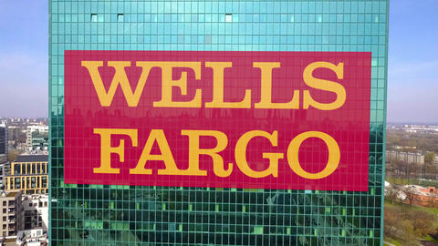 Aerial shot of office skyscraper with Wells Fargo logo. Modern office building Live Action