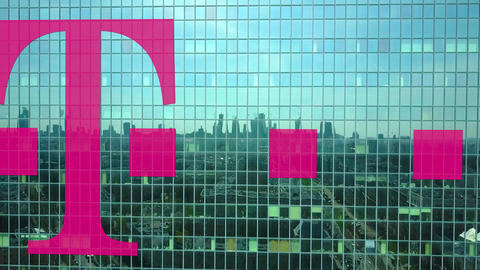 Aerial shot of office skyscraper with T-Mobile logo. Modern office building Live Action