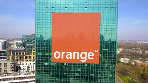 Aerial shot of office skyscraper with Orange S.A. logo. Modern office building Footage
