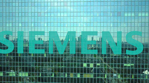 Aerial shot of office skyscraper with Siemens logo. Modern office building Footage