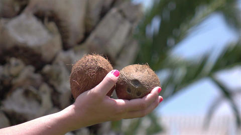 Video of woman holding coconuts in real slow motion Footage