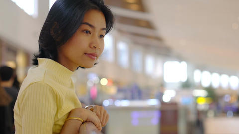 Portrait of Young Asian Woman in shopping mall Footage