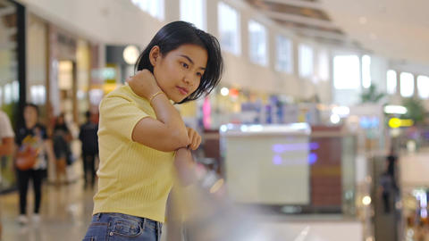 Young Asian Woman in shopping mall Footage